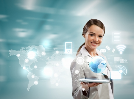 advance: Image of businesswoman with tablet pc against high-tech background
