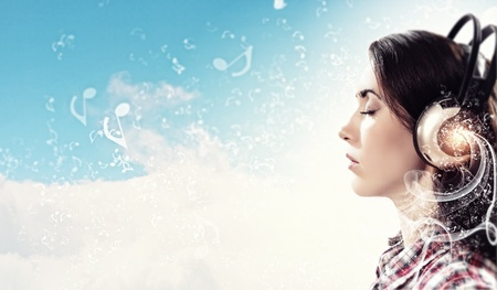 eyesclosed: Image of young pretty woman with headphones with eyes closed  Side view Stock Photo