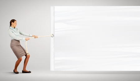 businesswoman card: Businesswoman pulling blank banner  Place for text