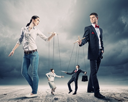 pr: Image of man and woman with marionette puppets Stock Photo