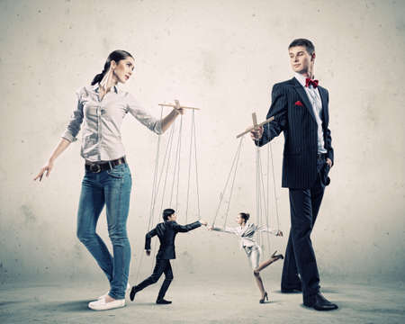 puppet: Image of man and woman with marionette puppets Stock Photo