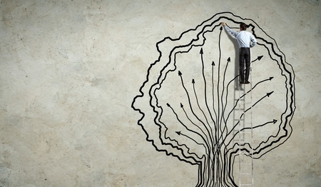 Back view image of businessman drawing graphics on wall Stock Photo - 19785009