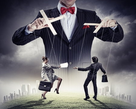 dictator: Image of young businessman puppeteer  Leadership concept Stock Photo