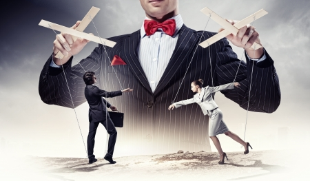 Image of young businessman puppeteer  Leadership concept photo