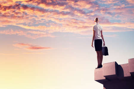 marketanalyze: Image of young businesswoman standing on top of building Stock Photo
