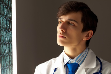 Image of male radiollogist with x-ray results photo