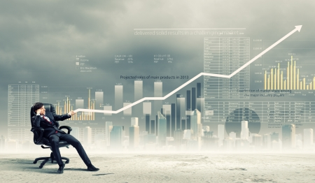 strong growth: Image of young businessman pulling graph  Chart growth concept