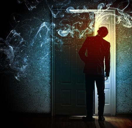 door opening: Image of young businessman standing with back opening door against smoke background