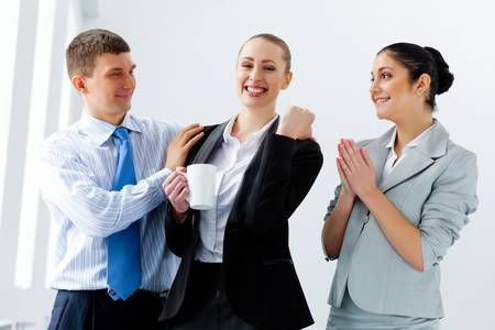 joyfully: Image of three young businesspeople laughing joyfully