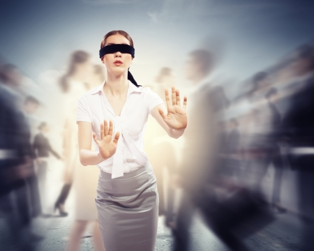 confused woman: Image of businesswoman in blindfold walking among group of people