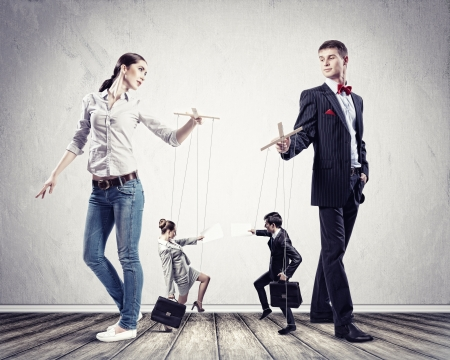 Image of man and woman with marionette puppets photo