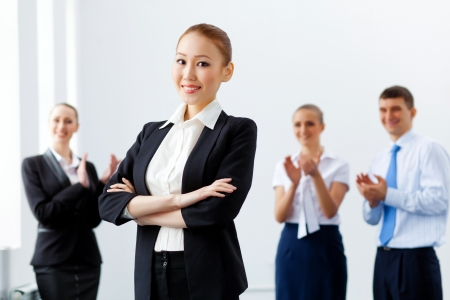 Image of four pretty young businesswomen standing in row photo