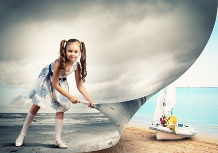 to another: Little girl turning page with another reality Stock Photo