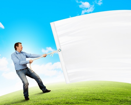 Adult man pulling blank banner  Place for text photo