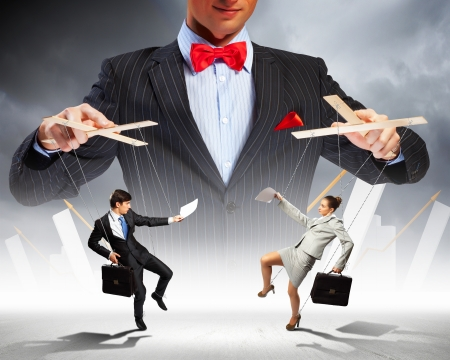 boss and employee: Image of young businessman puppeteer  Leadership concept Stock Photo