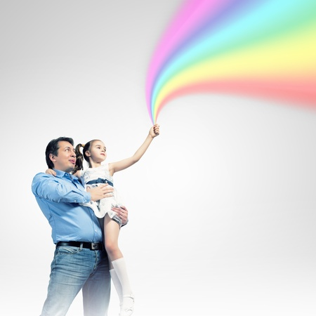Image of happy father holding on hands daughter ad rainbow Stock Photo - 19932019