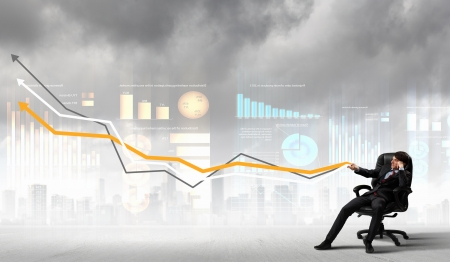 financial gains: Image of young businessman pulling graph  Chart growth concept