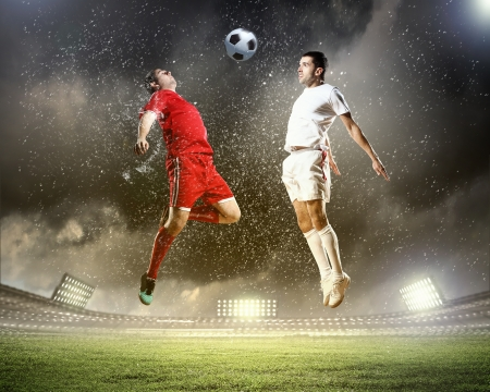 football players: Image of two football players at stadium Stock Photo