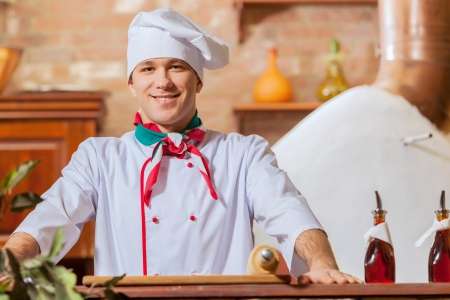 Image of young handsome male cook at kitchen photo