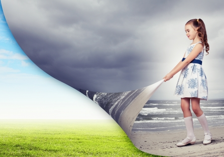 turns: Little girl turning page with another reality Stock Photo