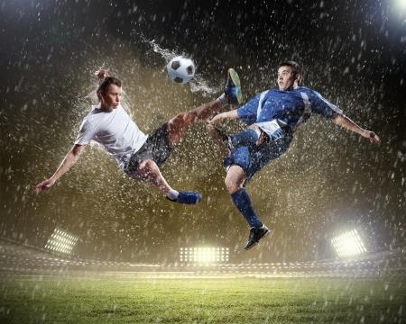 football symbol: Image of two football players at stadium Stock Photo
