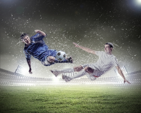 kick ball: Image of two football players at stadium Stock Photo