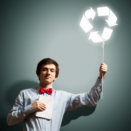 Image of young businessman with notebook  Recycling concept photo