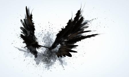 明るい背景に対して黒い翼の抽象的なイメージ