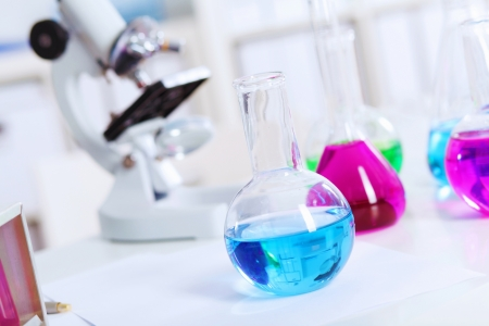 Chemistry laboratory glassware with colour liquids in them Stock Photo - 20024602