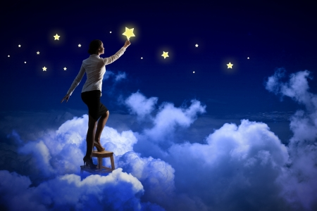 night shirt: Image of young woman lighting stars in night sky Stock Photo