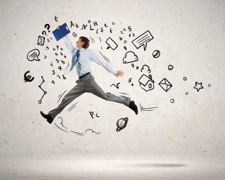 business collage: Image of jumping young businessman  Business collage Stock Photo