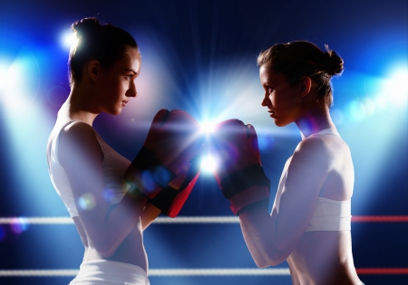 female boxer: Two boxer women in gloves greet each other before fight