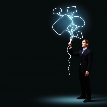 Image of businessman in black suit against dark background photo