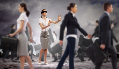 incapacity: Image of businesswoman in blindfold walking among group of people