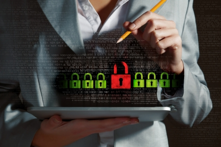 cyber defence: Businesswoman holding tablet pc entering password  Security concept Stock Photo