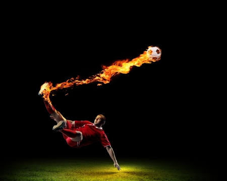soccer uniforms: Image of football player in red shirt Stock Photo
