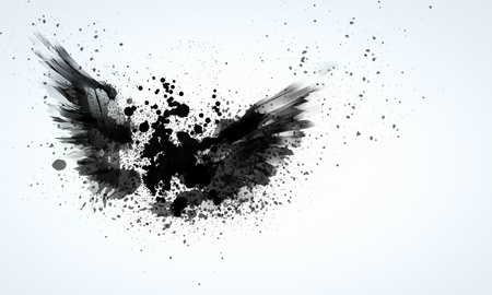 Abstract image of black wings against light background photo