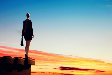 Image of young businesswoman standing on top of building Stock Photo