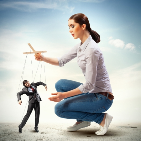 exploitation: Image of pretty businesswoman puppeteer  Leadership concept Stock Photo