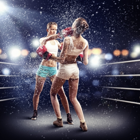 girl with rings: Two young pretty women boxing in ring