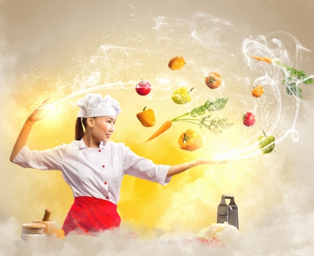 Asian female cooking with magic against color background Banco de Imagens - 20083588