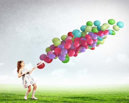 Image of little cute girl with bunch of color balloons photo