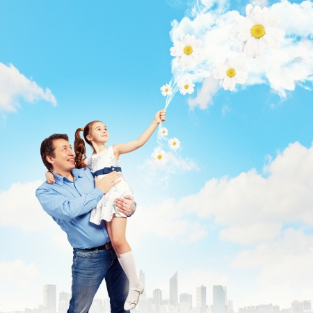 Image of happy father holding on hands daughter Stock Photo