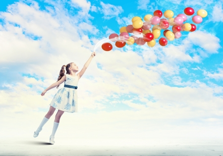 Image of little pretty girl playing with balloons photo
