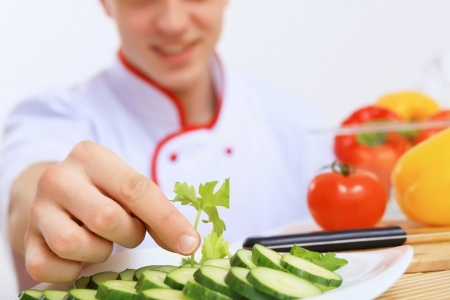 Young cook preparing food from fresh vegetables Stock Photo - 20148750