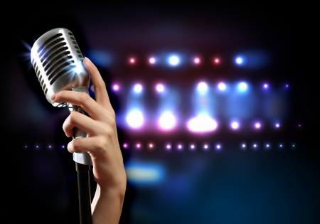 entertainment background: Female hand holding a single retro microphone against colourful background