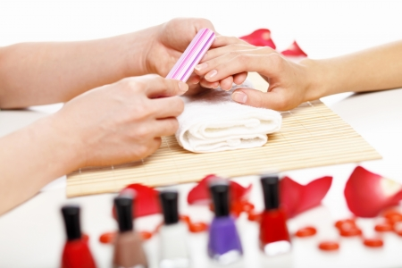 Young woman is getting manicure in a beauty salon photo