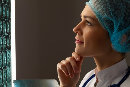 Image of attractive woman doctor looking at x-ray results Stock Photo - 20149563