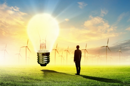 Image of businessman looking at light bulb  Green energy concept photo