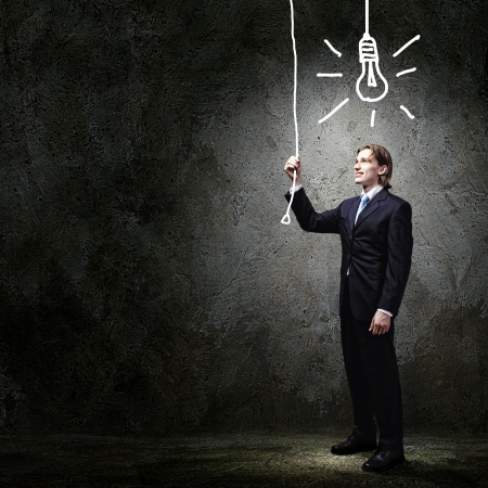new idea: Image of businessman in black suit against dark background